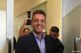Argentine politician Sergio Massa smiles after a meeting with presidential candidate Alberto Fernandez (not pictured), in Buenos Aires, Argentina, June 12, 2019.