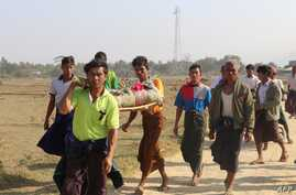 Residents carrying a body of an ethnic Rakhine woman for burial in Rathedaung township after fresh fighting in Rakhine state between the Myanmar military and the Arakan Army, an ethnic Rakhine force, Feb. 21, 2019.