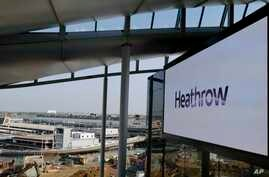 FILE - A photo shows a large screen at Heathrow Airport Terminal 2 in London, Britain, April 23, 2014.