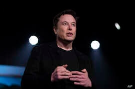 FILE - Tesla CEO Elon Musk speaks before unveiling the Model Y at the company's design studio in Hawthorne, California, March 14, 2019.