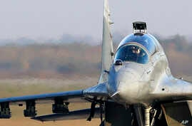 FILE - A Serbian Army MiG-29 jet fighter prepares for flight at the military airport Batajnica near Belgrade, Serbia, Oct. 17, 2017.