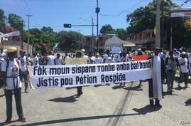 Haitian journalists, joined by supporters, march in Port-au-Prince, Haiti, Sunday to demand justice for their murdered colleague, Petion Rospide, June 16, 2019.