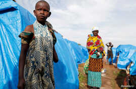 A girl who had part of her arm chopped off by militiamen when they attacked her village of Tchee, stands in a camp for internally displaced people in Bunia, Ituri province, Democratic Republic of Congo, April 12, 2018.
