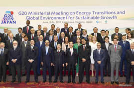 Ministers and delegates gather for a family photo session at G20 energy and environment ministers meeting in Karuizawa, Japan, June 15, 2019, in this photo taken by Kyodo.