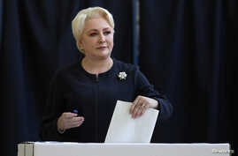 Romanian Prime Minister Viorica Dancila casts her vote during the European Parliament Elections in Bucharest, May 26, 2019.