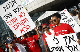 "A woman holds a banner reading in Hebrew ""don't fear Israel don't fire,"" left, as Israelis of Ethiopian origin protest in Tel Aviv, July 8, 2019, after a young man of Ethiopian origin was killed by an off-duty police officer in Israel on June 30."