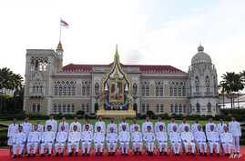 Thailand's Prime Minister Prayuth Chan-ocha, front center, poses with members of the new Thai cabinet at Government House in Bangkok on July 16, 2019.
