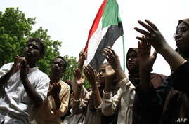 Scores of students of a Khartoum-based university celebrate after an agreement was reached between protest leaders and members of the Transitional Military Council in the Sudanese capital, July 17, 2019.