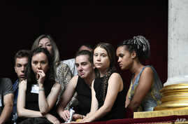 Swedish climate activist Greta Thunberg (2nd-R) attends a session of questions to the government at the French National Assembly in Paris after an earlier speech.