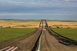 The Dakota Access Pipeline being installed between farms, as seen from 50th Avenue in New Salem, North Dakota, 25 August 2016