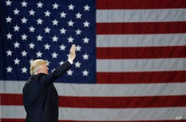 President Donald Trump with the US flag