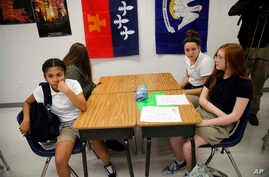 FILE - Students attend an eight grade class  at Southside Middle School in Denham Springs, La.