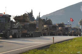 Turkish military trucks carrying tanks and personnel carriers are destined for the border with Syria,  Jan. 14, 2019.