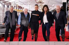 FILE - (L-R) Recording Academy pres. Neil Portnow, exec. producer Ken Erhlich, host Alicia Keys, producer Chantel Sausedo, and CBS' Jack Sussman, Exec. VP, Specials, Music, and Live Events, roll out the Grammy Awards red carpet, Feb. 7, 2019, Los Angeles.