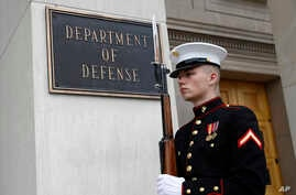 A member of the U.S. Marine Corps participates in an arrival ceremony for Japan's Defense Minister Takeshi Iwaya at the Pentagon