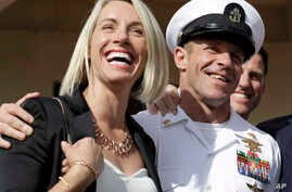 Navy Special Operations Chief Edward Gallagher, left, and his wife, Andrea Gallagher smile after leaving a military court on Naval Base San Diego, July 2, 2019, in San Diego.