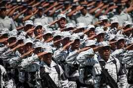 National Guard soldiers salute as the new force is presented during a ceremony at a military field in Mexico City, June 30, 2019..