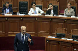 Albanian Prime Minster Edi Rama speaks during a parliament session in Tirana,, July 8, 2019.