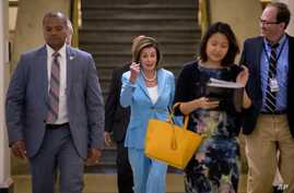 House Speaker Nancy Pelosi of Calif. arrives for a House Democratic caucus meeting on Capitol Hill in Washington, July 10, 2019.