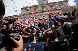 The U.S. women's soccer team celebrates at City Hall after a ticker tape parade, Wednesday, July 10, 2019, in New York.