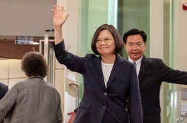 FILE - Photo released by the Taiwan Presidential Office shows Taiwanese President Tsai Ing-wen waving as she leaves for the Caribbean from Taoyuan International Airport in Taoyuan, Taiwan, July 11, 2019.