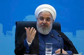 FILE - Photo released by the official website of the office of the Iranian Presidency, shows President Hassan Rouhani speaking in a meeting during his provincial tour to the North Khorasan, Iran, July 14, 2019.