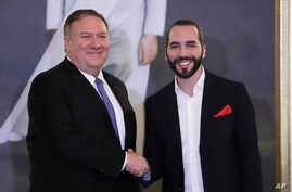 U.S. Secretary of State Mike Pompeo, left, shakes hands with El Salvador's President Nayib Bukele at the Presidential House.