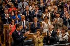 Spain's caretaker Prime Minister Pedro Sánchez (Bottom-L) is applauded by Socialist party colleagues during the parliamentary debate at the Spanish parliament in Madrid, Spain, July 22, 2019.