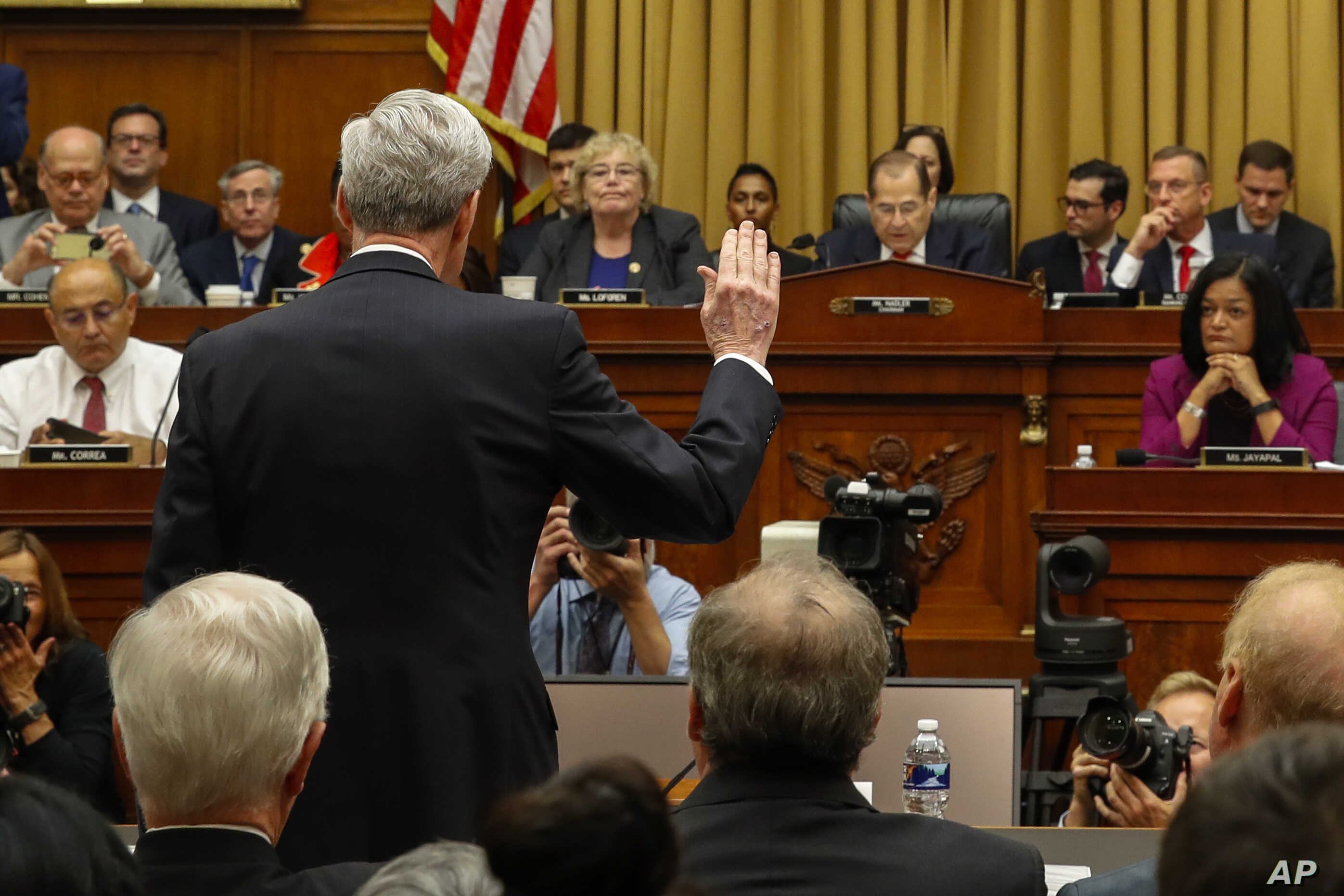 FILE - Former special counsel Robert Mueller is sworn in by House Judiciary Committee Chairman Jerrold Nadler, D-N.Y., to testify before the House Judiciary Committee hearing on his report on Russian election interference, on Capitol Hill, July 24, 2019.