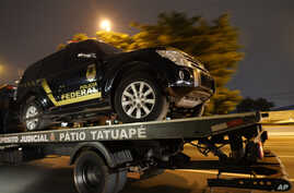 A fake police truck that was used in robbery is transported on a flat-bed truck in Sao Paulo, Brazil, July 25, 2019.