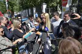 The physician treating Russian opposition leader Alexei Navalny, Dr. Anastasiya Vasilyeva speaks to journalists at a hospital after Navalny was discharged, in Moscow, Russia, July 29, 2019.