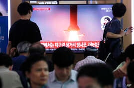 People watch a TV showing a file image of North Korea's missile launch during a news program at the Seoul Railway Station in Seoul, South Korea, July 31, 2019.