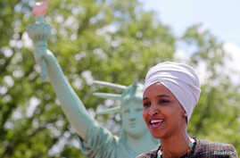 FILE - U.S. Representative Ilhan Omar addresses a rally on immigration rights at the temporary installation of a replica of the Statue of Liberty at Union Station in Washington, May 16, 2019.