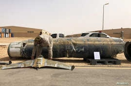 FILE - A projectile and a drone launched at Saudi Arabia by Yemen's Houthis are displayed at a Saudi military base, Al-Kharj, Saudi Arabia, June 21, 2019.