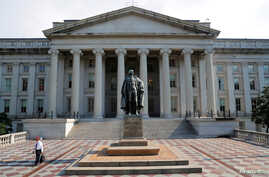FILE PHOTO: A man walks away from the U.S Treasury Department in Washington.