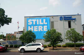 "FILE - A banner stating ""Still here"" hangs on the side of the Planned Parenthood building in St. Louis, Missouri, May 31, 2019."