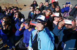 People test their special solar glasses before the solar eclipse in La Silla European Southern Observatory (ESO) at Coquimbo, Chile, July 2, 2019.
