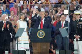 """U.S. President Donald Trump, first lady Melania Trump, Vice President Mike Pence, Acting Secretary of Defense Mark Esper and Chairman of the Joint Chiefs of Staff General Joseph Dunford attend the """"Salute to America"""" event in Washington, July 4, 2019."""