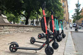 Electric scooters from Swedish startup VOI and Belin-based Tier sit parked side-by-side in Stockholm, Sweden, July 7, 2019.