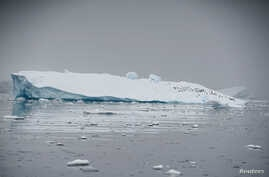 FILE - An iceberg floats in Andvord Bay, Antarctica, Feb. 14, 2018.