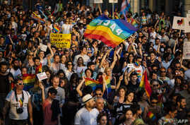 "People hold a rainbow flag reading ""Peace"" as they take part in the annual Gay Pride Parade in downtown Sofia, Bulgaria, June 8, 2019."