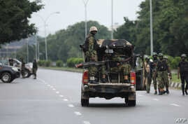 Soldiers aboard a truck patrol during a violent protest by Shiite Muslims demanding the release of their detained leader Ibrahim Zakzaky, July 23, 2019, in Abuja.