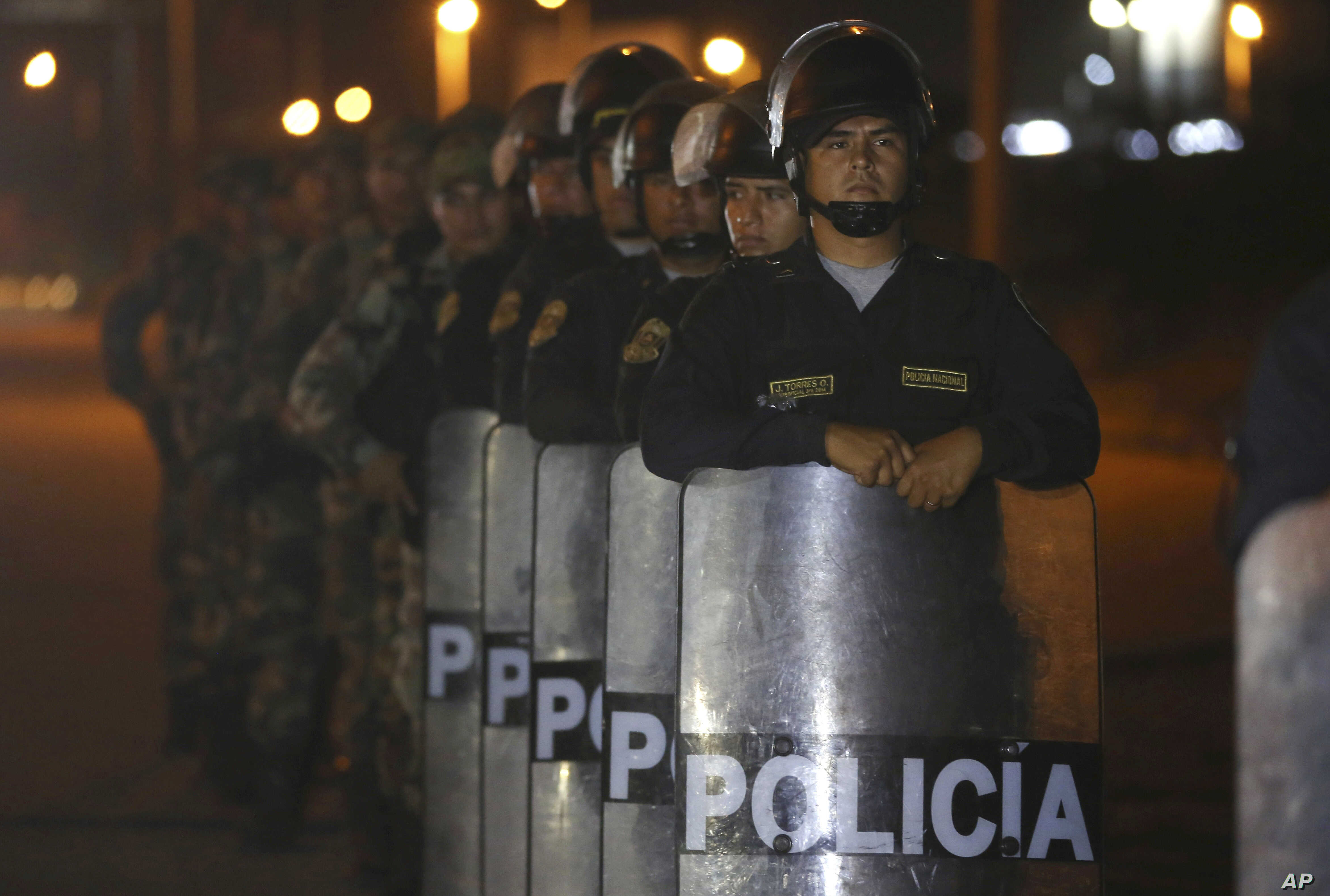 Police officers stand guard near Ecuador's border with Peru, in Tumbes, Peru, June 15, 2019.