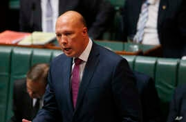Australian Home Affairs Minister Peter Dutton addresses Parliament House in Canberra, July 24, 2019.