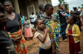 Parents and children wait to be vaccinated in Beni, Congo, July 13, 2019.