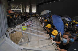 Protesters are seen as they forcefully enter the Legislative Council in Hong Kong, July 1, 2019.