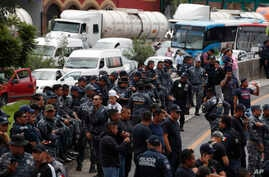 Uniformed federal police block the highway between Mexico City and Pachuca in both directions as part of a protest against plans to absorb them into the newly formed National Guard, in Ecatepec, Mexico, July 3, 2019.