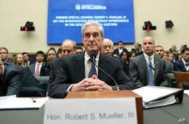 Former special counsel Robert Mueller listens to committee members give their opening remarks before he testifies before the House Intelligence Committee on his report on Russian election interference, on Capitol Hill, in Washington, July 24, 2019.