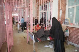 Women are treated for suspected cholera infection at Al-Sabeen hospital, in Sanaa, Yemen, Mar. 30, 2019.