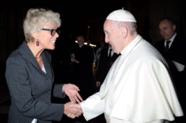 Pope Francis shakes hands with a Christiane Murray in an undated photo. (Source - Catholic News Service, Twitter @CatholicNewsSvc)